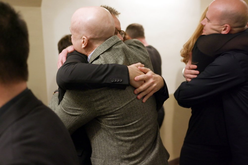 craig-johnson-and-conspirare-hugging-after-a-show